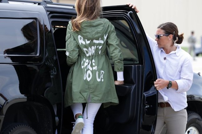 JOINT BASE ANDREWS, MD - JUNE 21: U.S. first lady Melania Trump (C) climbs back into her motorcade after traveling to Texas to visit facilities that house and care for children taken from their parents at the U.S.-Mexico border June 21, 2018 at Joint Base Andrews, Maryland. The first lady is traveling to Texas to see first hand the condition and treatment that children taken from their families at the border were receiving from the federal government. Following public outcry and criticism from members of his own party, President Donald Trump signed an executive order Wednesday to stop the separation of migrant children from their families, a practice the administration employed to deter illegal immigration at the U.S.-Mexico border. (Photo by Chip Somodevilla/Getty Images)